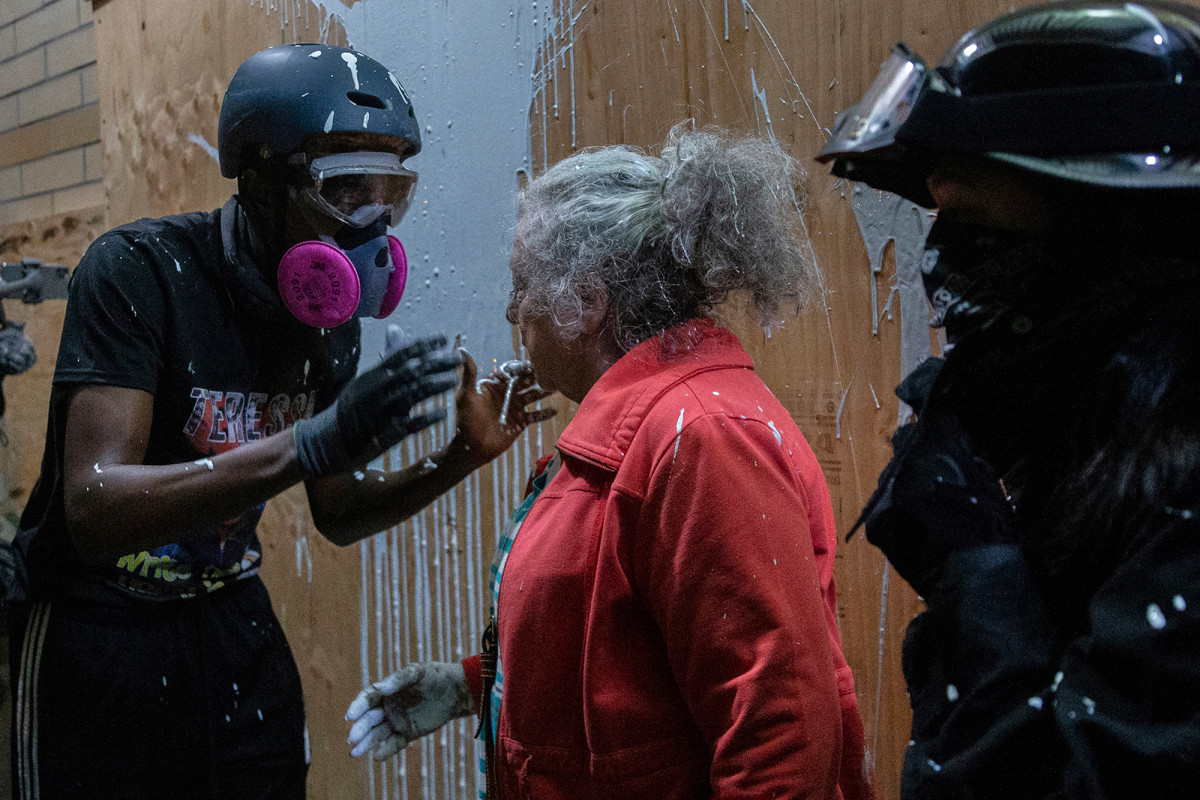 Portland woman confronts protesters, splattered with paint